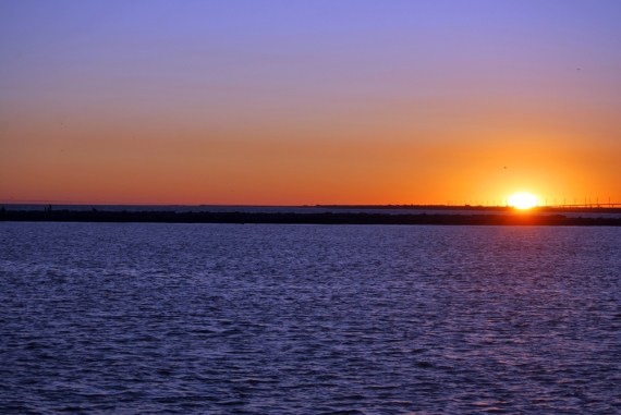 Sunset over Jetty Pier as viewed from Surfside Free Beach in south Texas!
