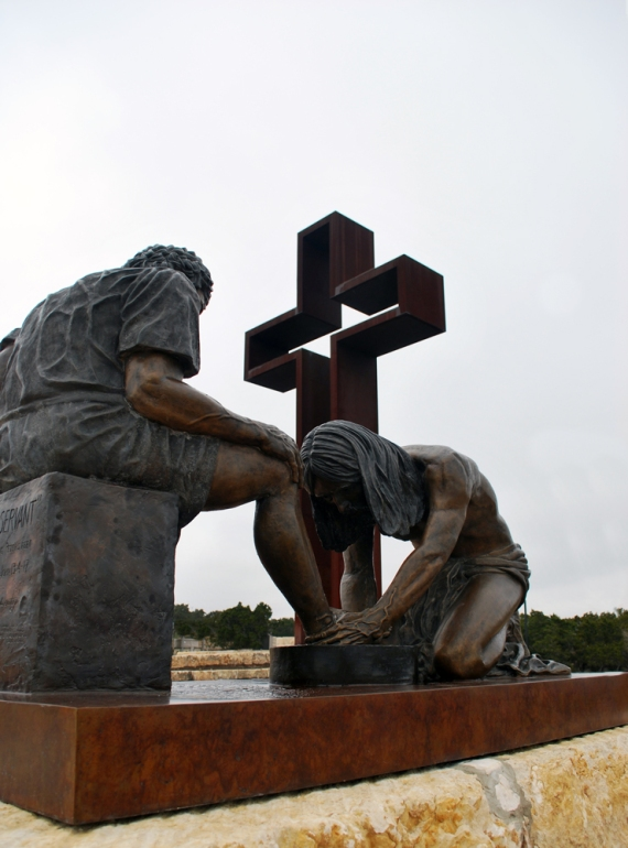 "Two of many sculptures found at Kerrville, TX. The Divine Servant of Jesus with the Empty Cross in the background. ""I did not come to be served but to serve!"""
