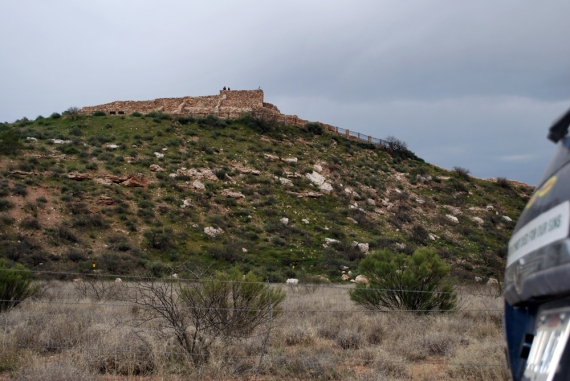 BigBlue looking up to the hill where the millennium-old 110-room, 3-story pueblo of Tuzigoot National Monument is positioned