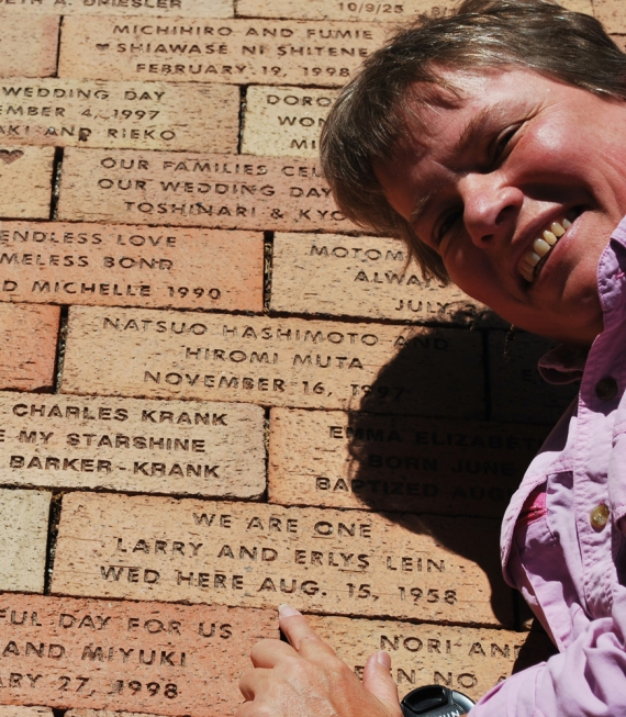 Deb at commemorative brick at Wayside Chapel