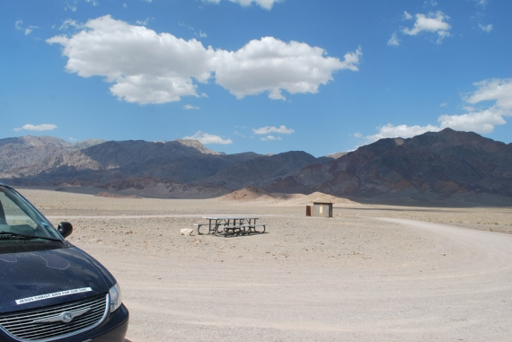 "Death Valley rest area on the way to Badwater Basin, the 2nd lowest point in the western hemisphere. Sure! It looks all calm and clear...but within seconds, a sand storm stirred up right after I had poured water over my head! Can you say, ""sandpaper hair""?!"